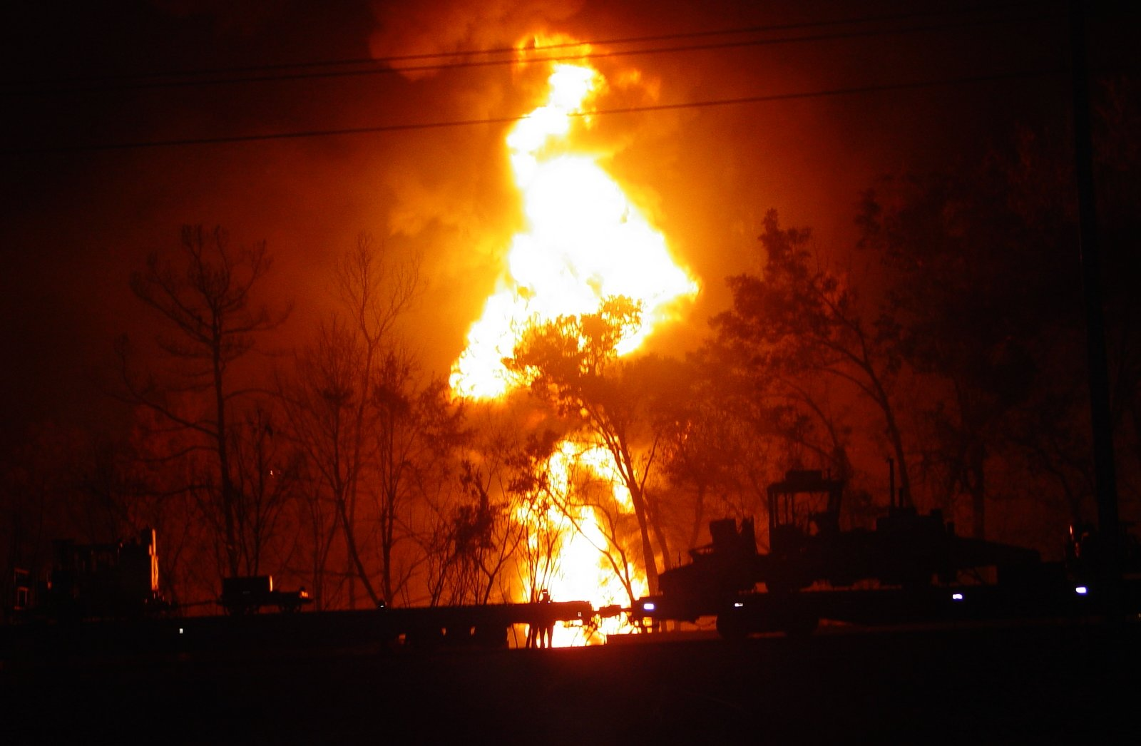 Large fire erupts throughout the night, as a result from the train derailment.